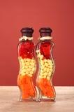 Deux bouteilles avec le poivron rouge Photo libre de droits
