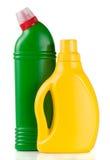 Deux bouteilles de détergents d'isolement sur le fond blanc Image stock