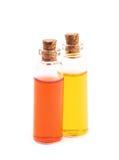 Deux bouteilles remplies de liquide coloré Photographie stock libre de droits