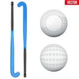Deux bâtons et boules classiques pour l'hockey de champ Image libre de droits
