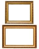 Deux cadres de tableau en bois plaqués par or d'isolement Images stock