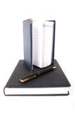 Deux cahiers avec le crayon lecteur. Photographie stock libre de droits
