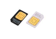 Deux cartes de SIM pour des téléphones mobiles d'isolement Photographie stock libre de droits