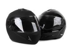 Deux casques noirs de moto d'isolement Image libre de droits