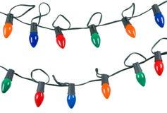 Deux chaînes de caractères des lumières de Noël d'isolement sur le blanc Photographie stock libre de droits