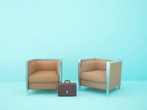 Deux chaises brunes dans la salle bleue Images stock