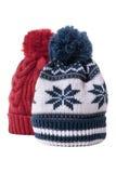 Deux chapeaux de knit de laine d'hiver d'isolement sur le fond blanc Photos stock