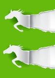 Deux chevaux de papier déchirant le papier Photo libre de droits