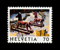 `Deux chevaux` by Jean-Frédéric Schnyder, View of Switzerland serie, circa 1998. MOSCOW, RUSSIA - SEPTEMBER 3, 2017: A stamp printed in Switzerland Royalty Free Stock Photo