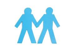Deux chiffres se tenir de bâton de papier bleu remet le fond blanc Image stock