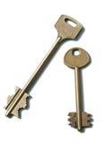 Deux clés d'or sur un fond blanc Image libre de droits