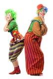 Deux clowns de sourire sont de nouveau au dos Photographie stock libre de droits
