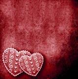 Deux coeurs à l'arrière-plan rouge Images libres de droits