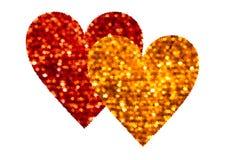 Deux coeurs abstraits rouges et d'or sur le blanc Photographie stock libre de droits