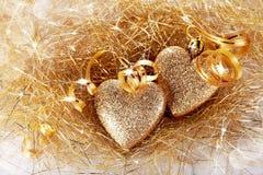 Deux coeurs avec des bandes d'or Photo libre de droits