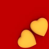 Deux coeurs d'or sur le rouge image libre de droits