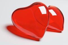 Deux coeurs en verre rouges Photographie stock libre de droits