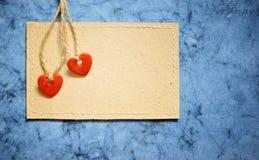 Deux coeurs sur une carte Image libre de droits