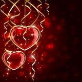 Deux coeurs et tresses rouges Photographie stock