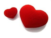 Deux coeurs rouges sur le blanc image stock