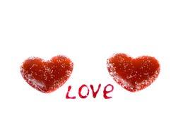 Deux coeurs rouges sur un fond blanc et les mots Image libre de droits