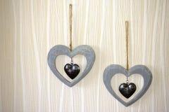 Deux coeurs sur le mur Images stock