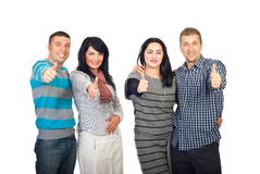 Deux couples donnant des pouces Photos libres de droits