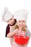 Deux cuisiniers d'enfants Photographie stock libre de droits