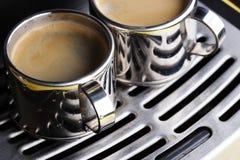 Deux cuvettes de café express chaud Photographie stock libre de droits