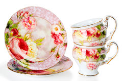 Deux cuvettes et soucoupes de café décorées des fleurs Images stock