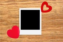 Deux décorations en forme de coeur rouges du rouge de la valentine/Noël Photo stock