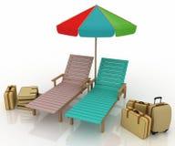Deux deckchairs sous un parapluie Photos libres de droits