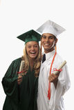 Deux diplômés dans le capuchon et la robe Images libres de droits
