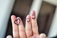 Deux doigts et coeurs heureux Photo libre de droits