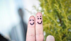 Deux doigts et coeurs heureux Photographie stock