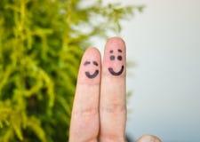 Deux doigts et coeurs heureux Images stock