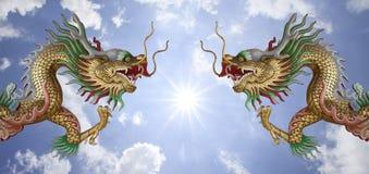 Deux dragons et le soleil Image libre de droits