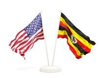Deux drapeaux de ondulation des Etats-Unis et de l'Ouganda d'isolement sur le blanc illustration stock
