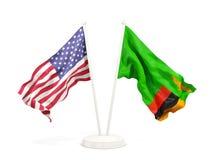 Deux drapeaux de ondulation des Etats-Unis et de la Zambie d'isolement sur le blanc illustration stock