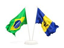 Deux drapeaux de ondulation du Brésil et des Barbade d'isolement sur le blanc illustration stock