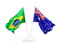 Deux drapeaux de ondulation du Brésil et de l'australie d'isolement sur le blanc illustration de vecteur