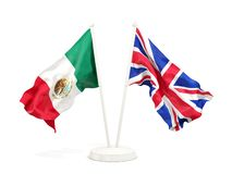 Deux drapeaux de ondulation du Mexique et du R-U d'isolement sur le blanc illustration libre de droits