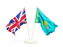 Deux drapeaux de ondulation du R-U et du Kazakhstan d'isolement sur le blanc illustration stock