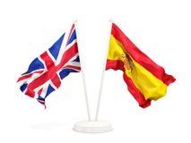 Deux drapeaux de ondulation du R-U et de l'Espagne illustration stock