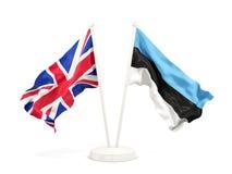 Deux drapeaux de ondulation du R-U et de l'Estonie illustration libre de droits