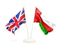Deux drapeaux de ondulation du R-U et de l'Oman d'isolement sur le blanc illustration de vecteur