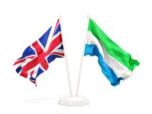 Deux drapeaux de ondulation du R-U et de la Sierra Leone d'isolement sur le blanc illustration stock