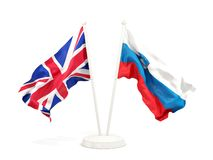 Deux drapeaux de ondulation du R-U et de la Slov?nie d'isolement sur le blanc illustration libre de droits