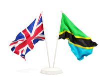Deux drapeaux de ondulation du R-U et de la Tanzanie d'isolement sur le blanc illustration de vecteur