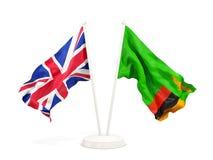 Deux drapeaux de ondulation du R-U et de la Zambie d'isolement sur le blanc illustration libre de droits